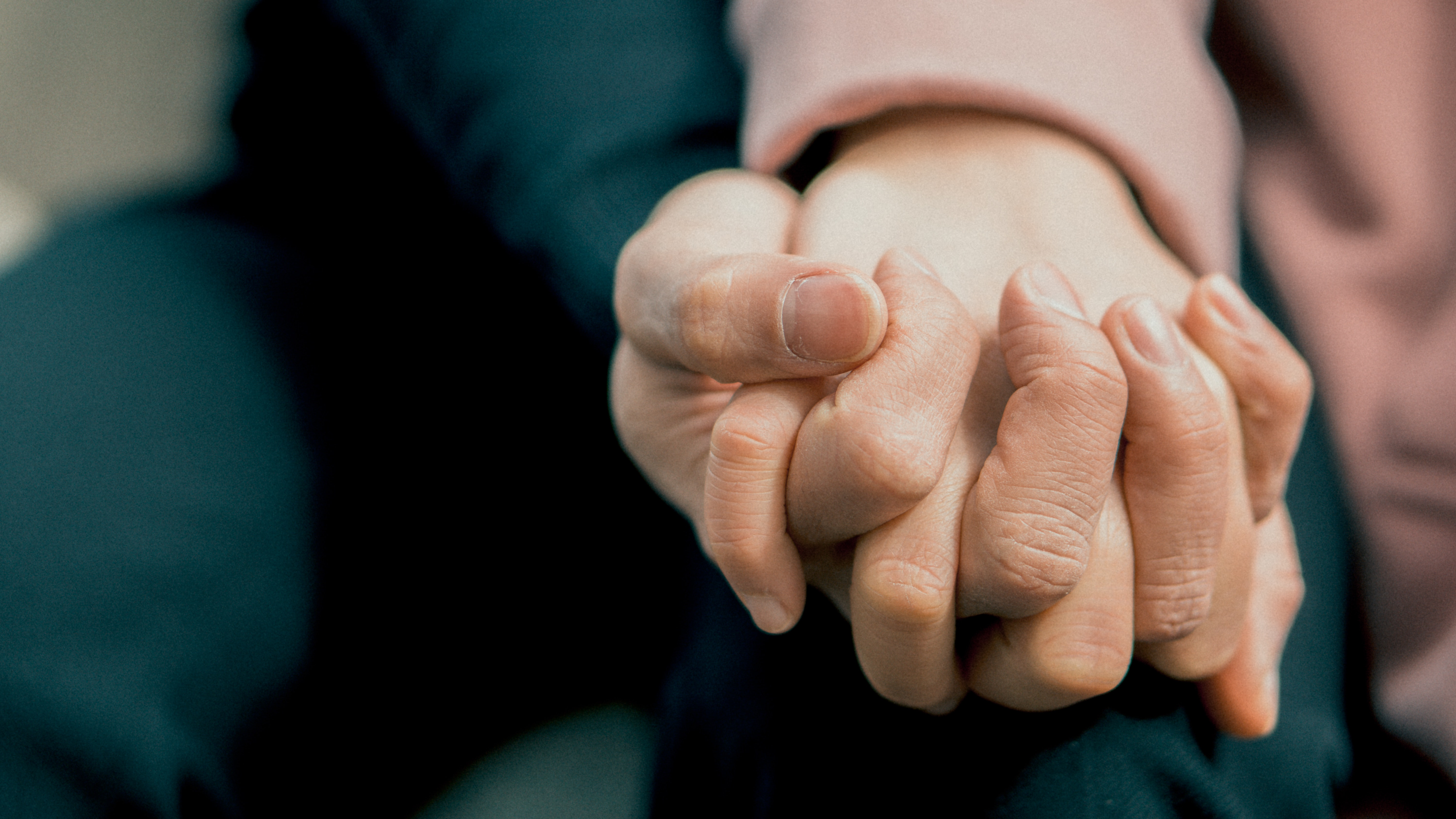 caring-for-the-caregivers-holding-hands-expat-nest