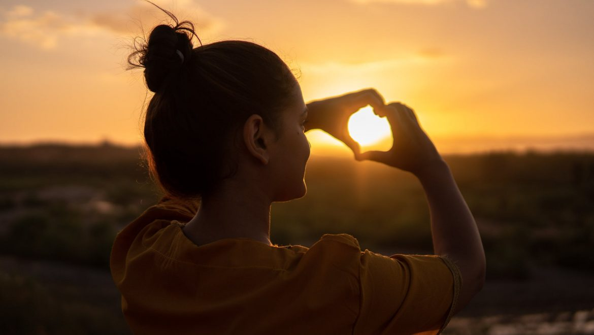 self-compassion_expat nest_woman with heart hands_Hassan Ouajbir (Pexels)